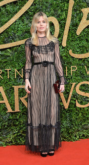Georgia May Jagger went the boho route in a sheer black peasant dress with a nude underlay during the British Fashion Awards.