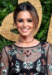 Cheryl Fernandez-Versini attended the British Fashion Awards wearing this messy-chic updo.