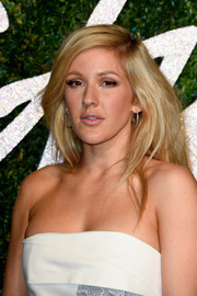 Ellie Goulding stuck to her trademark high-volume side-parted style when she attended the British Fashion Awards.