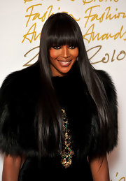Naomi Campbell rocked long straight locks with blunt cut bangs while attending the British Fashion Awards.