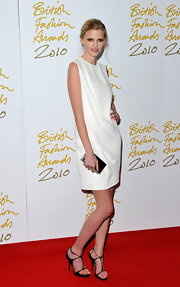 Lara Stone was minimalist perfect carrying a silver metal clutch by Calvin Klein.