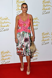 Yasmin paired her tropical cocktail dress with nude suede platforms.