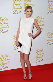 Lara goes for a minimalist style in this chic mod white dress.