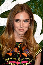 Chiara Ferragni wore her hair down with a center part and subtly wavy ends during the British Fashion Awards.