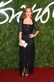 Charlotte Dellal chose a black lace gown with a fringed skirt for the British Fashion Awards.