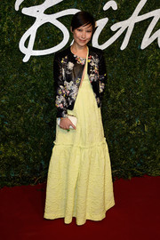 Sandra Choi was a rocker-chic princess at the British Fashion Awards in a floral leather jacket layered over a textured yellow gown.