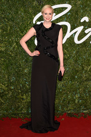 Gwendoline Christie posed on the British Fashion Awards red carpet in a floor-sweeping, embellished black dress by Giles.