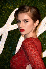 Tali Lennox looked elegant with her side-parted updo at the British Fashion Awards.