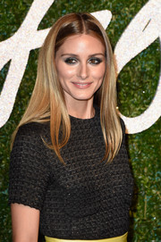 Olivia Palermo stuck to her signature center-parted style when she attended the British Fashion Awards.