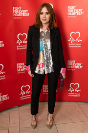Angela Scanlon rocked a pop of color in her menswear-inspired suit with a shimmering top underneath