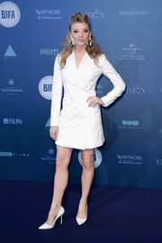 Natalie Dormer matched her dress with a pair of white Manolo Blahnik pumps.