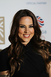 Mel C put a new spin on her trademark center part with these ultra-feminine curls.
