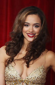 Actress Nathalie Emmanuel flaunted her long wavy cut while attending the British Soap Awards.