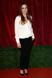 Mel C paired black slacks with a white faux-wrap top for a classy look during the 2012 British Soap Awards.