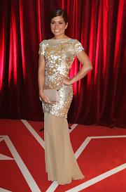 Nikki Sanderson complemented her sparkly dress with a simple nude envelope clutch at the British Soap Awards.