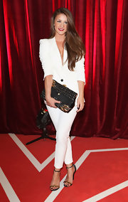 Brooke Vincent pulled her stylish look together with a multi-textured oversized black and gold clutch.