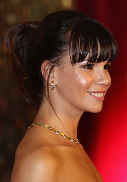 Jessica Fox looked chic and youthful with her ponytail and eye-grazing bangs at the British Soap Awards.