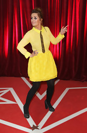 Zoe Henry showed off her original sense of style with this leopard-print tie and mini dress combo at the British Soap Awards.