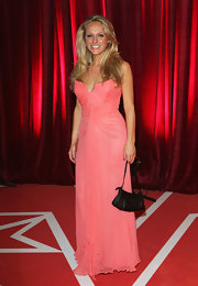 Sophie Abelson complemented her sweet dress with a simple black satin purse when she attended the British Soap Awards.