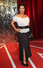 Jessie Wallace opted for a pair of black wide-leg pants and an off-the-shoulder top for her British Soap Awards red carpet look.