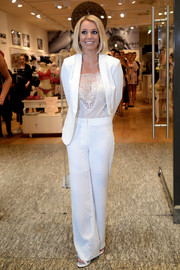 Britney Spears looked effortlessly chic in a white Michael Costello pantsuit teamed with a lacy top during the Intimate Collection launch.