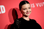 Miranda Kerr slicked her hair back into a center-parted updo for the celebration of Jasper Johns: 'Something Resembling Truth.'
