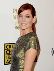 Carrie Preston pulled back her fiery red hair into a sleek and shiny low ponytail.