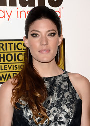 Jennifer Carpenter's pulled back 'do featured a teased crown and a flowing mane.
