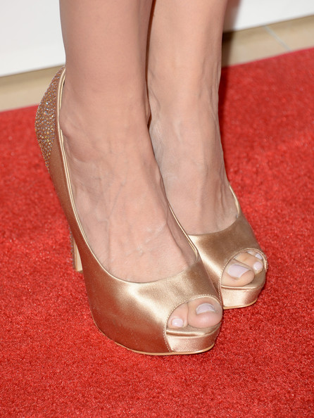 McKenzie Westmore's champagne satin peep-toe pumps featured bling on the heel for an added bit of pizazz!