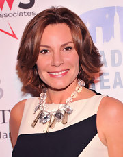 LuAnn de Lesseps accessorized her monochrome shift dress with a striking crystal statement necklace.