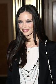 Georgina looked lovely with a center-parted, chunky layered hairstyle.