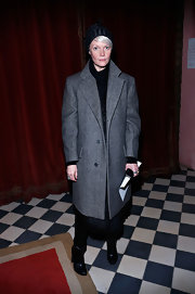 An over sized wool coat added some funky flare to Kate Lanphear's look.