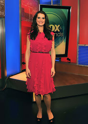 Brooke Shields complemented her ruffled rasberry dress with black platform peep toes.