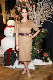 Ashley Greene kept it super simple in a short-sleeve tan top at the Brooks Brothers holiday celebration.