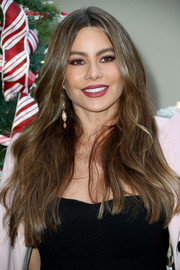 Sofia Vergara attended the Brooks Brothers Holiday celebration wearing her signature long center-parted hairstyle.