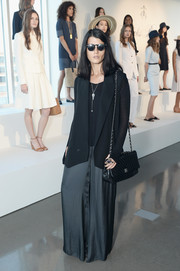 For her arm candy, Crystal Renn chose a classic quilted leather bag by Chanel.