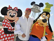 Actor Bruce Willis wore a Disney baseball cap to help promote Disney World.