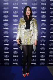 Eleonora Carisi teamed her suit with a pair of printed satin pumps.