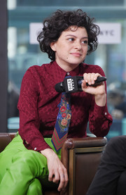 Alia Shawkat's floral tie, red shirt, and acid-green pants were a bold combination.