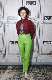 Alia Shawkat paired a red silk button-down with a colorful tie for her visit to Build Studio.