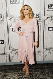 Kyra Sedgwick looked effortlessly stylish in a pink V-neck sweater dress with a pleated skirt while visiting 'Build.'