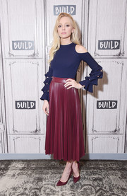 Portia Doubleday was cute and modern in a navy Jonathan Simkhai cold-shoulder knit top with tiered cutout sleeves while visiting Build Studio.