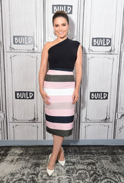 Sophia Bush donned a simple yet sophisticated one-shoulder top by Wolford for the Build Series.