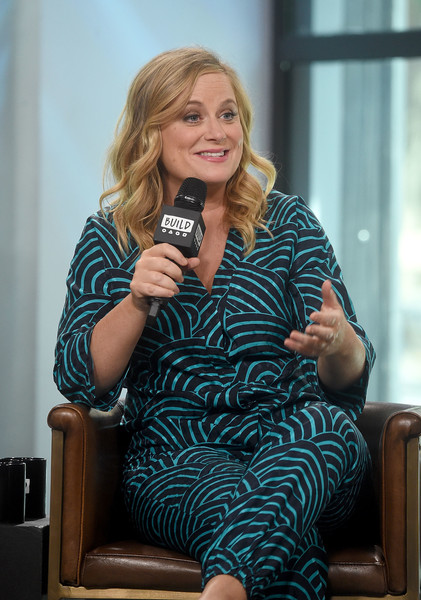 More Pics of Amy Poehler Print Blouse (5 of 31) - Amy Poehler Lookbook - StyleBistro [the house,movie,sitting,blond,leg,room,thigh,photography,long hair,brown hair,amy poehler,build presents will ferrell,new york city,build studios,build studio]