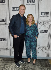 Amy Poehler visited Build wearing a scallop-patterned blouse.