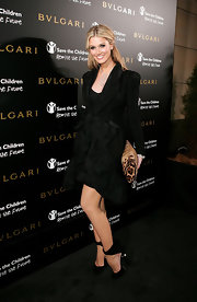 Delta Goodrem chose a feminine black skirt suit for the 125th anniversary celebration of Bulgari.