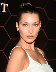 Bella Hadid wore her hair in a sleek bun at the 'Goldea, The Roman Night' fragrance launch.