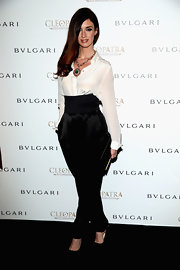 Paz Vega kept her look classic and sophisticated with this white button down, which she paired with a pair ob black high-waisted silk pants.