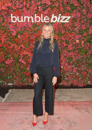 Black straight-leg trousers with red side stripes finished off Gwyneth Paltrow's outfit.