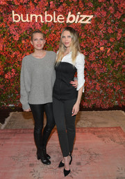 Erin Foster bundled up in a baggy gray sweater for the Bumble Bizz Los Angeles launch.